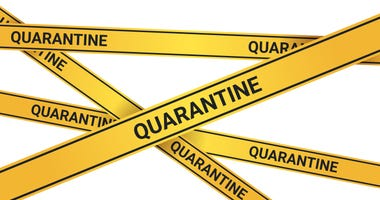 Quarantine caution on yellow warning tape coronavirus infection