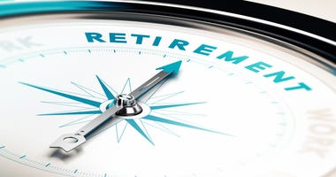 Compass with needle pointing the word retirement