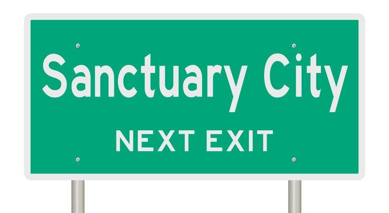 Sanctuary city highway sign