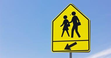 School crosswalk and arrow sign
