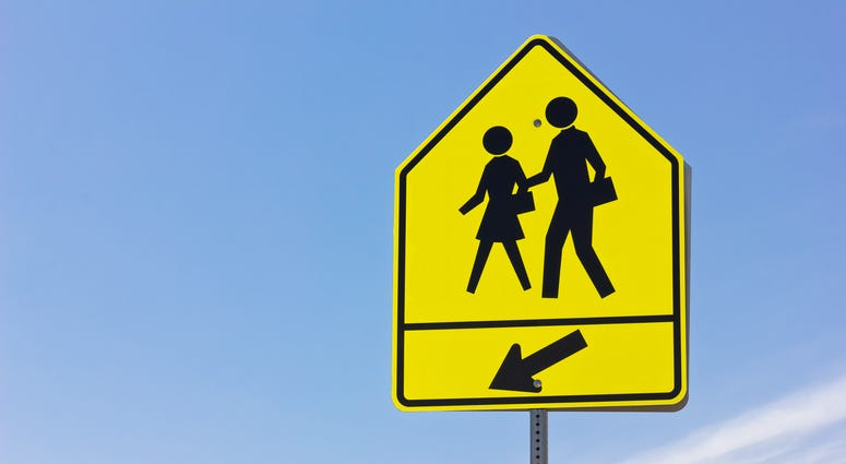 School crosswalk and arrow sign