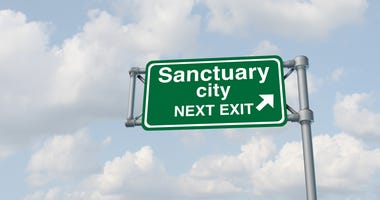 Sanctuary city concept and illegal immigration law government enforcement policies as a highway sign directing to welcoming immigrants with no legal status