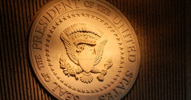 glowing presidential seal on wall