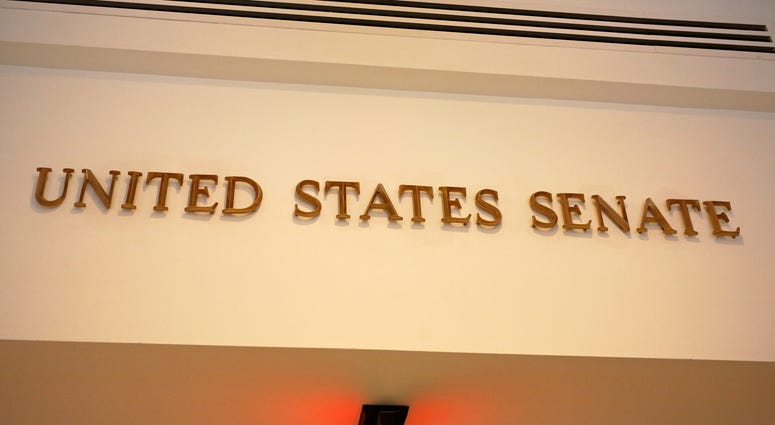 A sign marks an entrance to the United States Senate in the US Capitol building