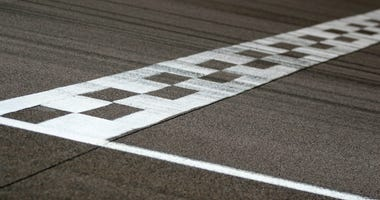 The painted start/finish line across a racetrack