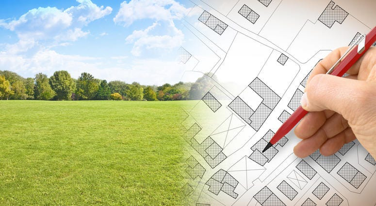 Construction plans- concept image with hand drawing and green land