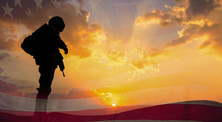 Double exposure Silhouette of Soldier on the United States flag in sunset for Veterans Day