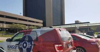Picture of Wichita city hall and a KNSS vehicle