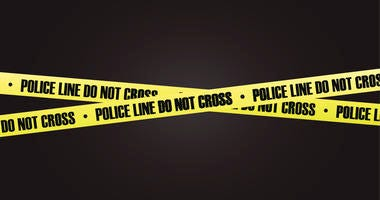 A photo of crime scene tape on a black background.