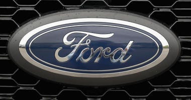 A Ford F-150 pickup truck is offered for sale at a dealership.