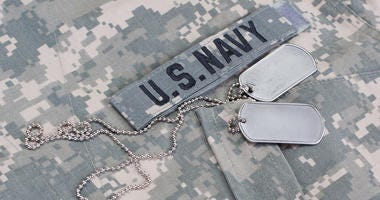 U.S. Navy camouflaged uniform with blank dog tags