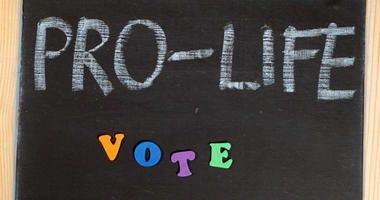 Pro-life abortion debate message on chalkboard