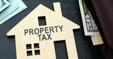 Property tax sign on a house model