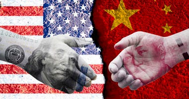 US dollar and China Yuan banknote print screen on handshake with both flags countries