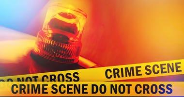 Crime scene do not cross yellow tape and orange flashing and revolving light