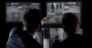 Agents monitoring CCTV footage