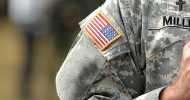 the American flag attached to the American military uniform