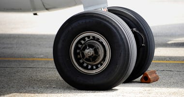 Detail shot with big airplane wheels and landing gear