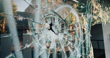 Shop window broken by riots