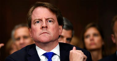 file photo, then-White House counsel Don McGahn listens as Supreme court nominee Brett Kavanaugh testifies before the Senate Judiciary Committee on Capitol Hill in Washington.