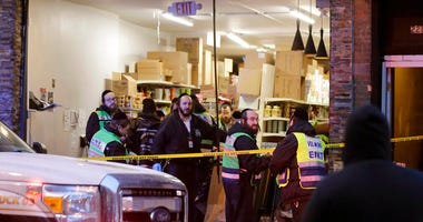 Emergency responders work at a kosher supermarket, the site of a shooting in Jersey City, N.J., Wednesday, Dec. 11, 2019.