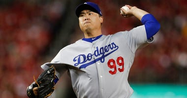 Los Angeles Dodgers starting pitcher Hyun-Jin Ryu throws to a Washington Nationals batter during the first inning in Game 3 of a baseball National League Division Series in Washington.