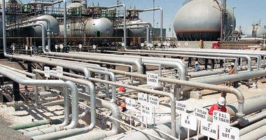 In this file photo dated 1990, Aramco refinery at Ras Tannura, Saudi Arabia. The price of oil surged Friday Jan. 3, 2020, as global investors were gripped with uncertainty over the potential repercussions and any retaliation, after the United States kille
