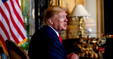 President Donald Trump speaks to members of the media following a Christmas Eve video teleconference with members of the military at his Mar-a-Lago estate in Palm Beach, Fla.