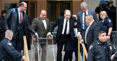 Harvey Weinstein, center, leaves court following a pre trial hearing, Monday, Jan. 6, 2020, in New York. The disgraced movie mogul faces allegations of rape and sexual assault.