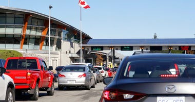 traffic enters Canada from the United States at the Peace Arch Border Crossing, in Blaine, Wash. The Washington state chapter of the Council on American-Islamic Relations says more than 60 Iranians and Iranian-Americans were detained and questioned at the