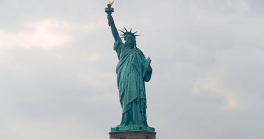 n this Aug. 14, 2019 file photo, The Statue of Liberty is shown in New York. The Department of Homeland Security says New York residents will be cut off from 'trusted traveler' programs because of a state law that prevents immigration officials from acces