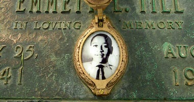 his May 4, 2005, file photo shows Emmett Till's photo on his grave marker in Alsip, Ill. Sixty-five years after 14-year-old Emmett Till was lynched in Mississippi, Congress is set to approve legislation designating lynching as a hate crime under federal l