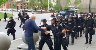 video provided by WBFO, a Buffalo police officer appears to shove a man who walked up to police (AP)