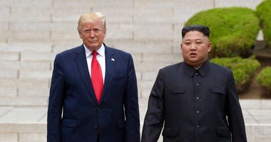 President Donald Trump, left, meets with North Korean leader Kim Jong Un at the North Korean side of the border at the village of Panmunjom in Demilitarized Zone (AP)