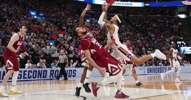 Auburn's Bryce Brown drives to the basket against New Mexico State in the first round of the 2019 NCAA Tournament.
