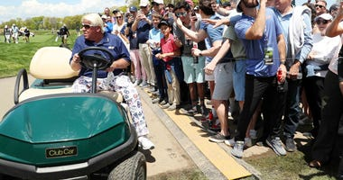 John Daly drives his cart up to the 10th hole at the 2019 PGA Championship at Bethpage Black.