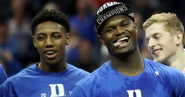 Duke's R.J. Barrett and Zion Williamson smile after winning the 2019 ACC tournament.