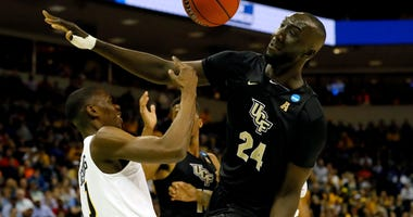 Tacko Fall of UCF blocks a shot against VCU in the first round of the 2019 NCAA Tournament.