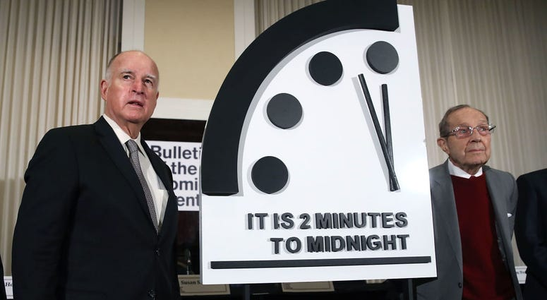 ANUARY 24: Former California Governor Jerry Brown, (L) and former U.S. Secretary of Defense William Perry unveil the Doomsday Clock during The Bulletin of the Atomic Scientists news conference, on January 24, 2019 in Washington, DC.