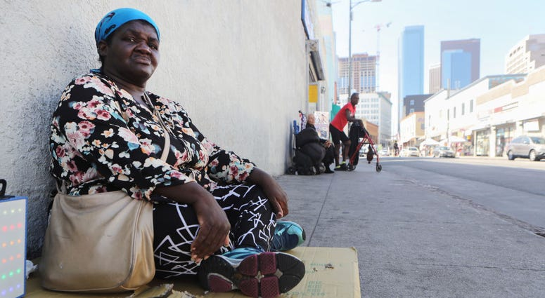 Margaret, who has been homeless since 2016, sits on the sidewalk in Skid Row on September 17, 2019 in Los Angeles, California.