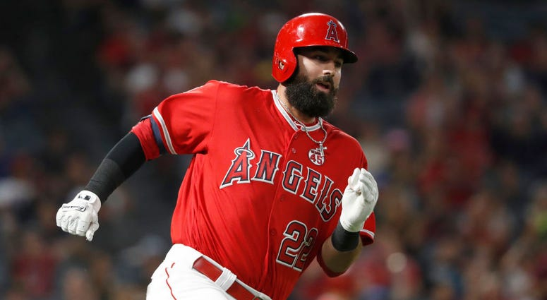 Kaleb Cowart #22 of the Los Angeles Angels of Anaheim runs to first base after hitting an RBI double during the seventh inning of a game against the Oakland Athletics at Angel Stadium of Anaheim on September 25, 2019 in Anaheim, California.