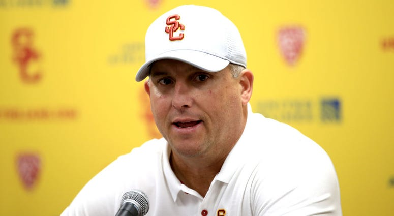 Head coach Clay Helton of the USC Trojans speaks to the media after defeating the UCLA Bruins 52-35 in a game at Los Angeles Memorial Coliseum on November 23, 2019 in Los Angeles, California.