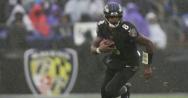 Quarterback Lamar Jackson #8 of the Baltimore Ravens rushes against the San Francisco 49ers during the third quarter at M&T Bank Stadium on December 01, 2019 in Baltimore, Maryland.