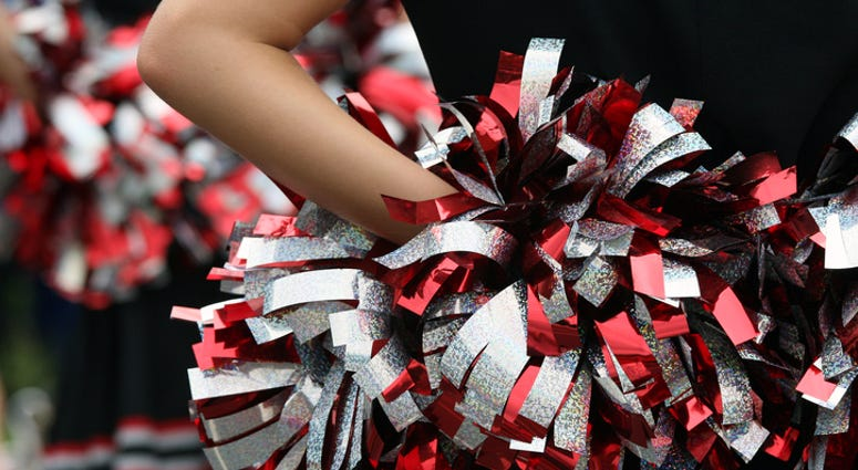young cheerleader with red silver & black pompom