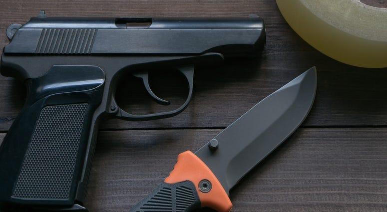 criminal news equipment. gun, knife, duct tape - stock photo