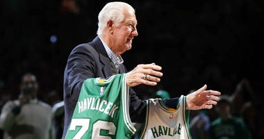 Boston Celtics great John Havlicek participates in a ceremony during a game in 2016.