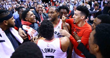 Kawhi Leonard and the Toronto Raptors celebrate his game-winning shot in Game 7 against the Philadelphia 76ers.