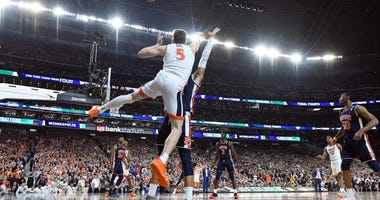 Kyle Guy of Virginia is fouled on a last-second 3-point attempt against Texas Tech in the 2019 Final Four.