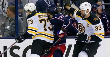 Charlie McAvoy of the Boston Bruins checks Josh Anderson of the Columbus Blue Jackets in the head during Game 6 in the 2019 NHL playoffs.