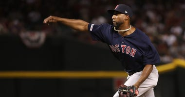Boston Red Sox infielder Eduardo Nunez delivers a pitch during a blowout loss to the Arizona Diamondbacks.